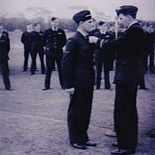 L.A.C. John Hunter Maher being presented his Pilot's Brevet by Air Marshal G. J. Jones (right), Chief of Air Staff R.A.A.F., 1 Service Flying Training School, Point Cook, Victoria